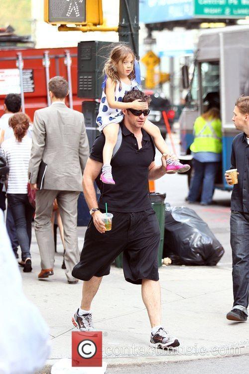 Hugh Jackman carries his daughter Ava Jackman home...