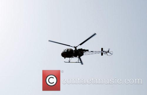 An Indian Air Army helicopter searches from sky...