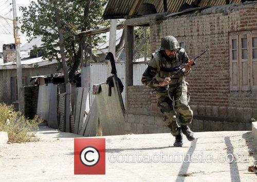 A soldier of the Indian Army runs during...