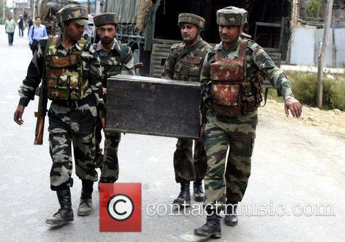 Indian Army soldiers prepare material as they try...