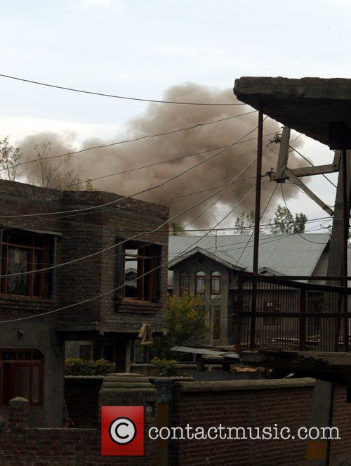 Smoke billows following an explosion as separatist militants...