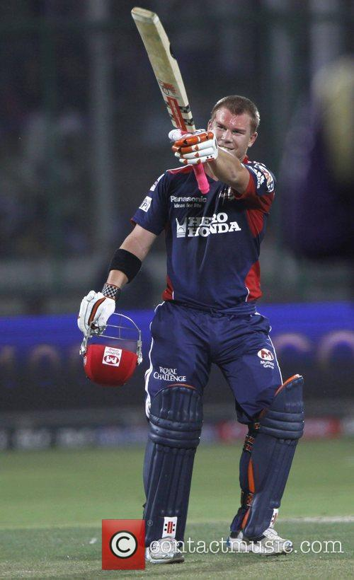 Delhi Daredevils player David Warner raises his bat...