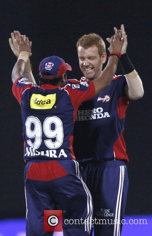 Delhi Daredevils player Andrew McDonald celebrates after taking...