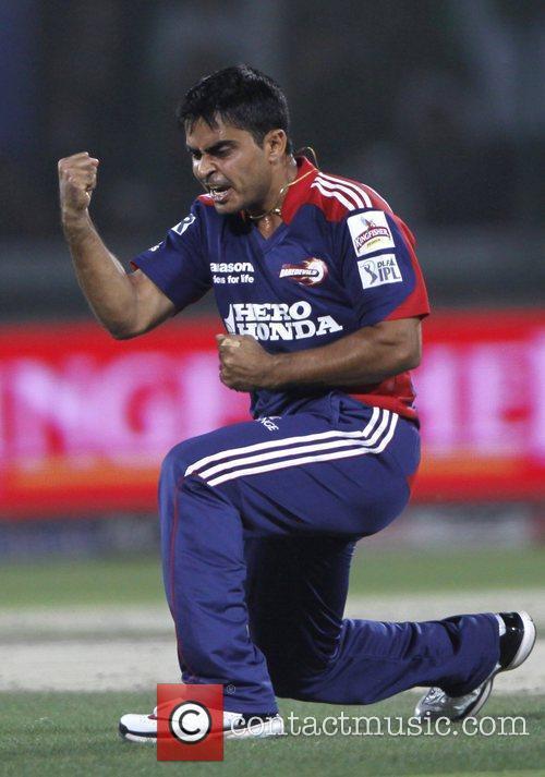 Delhi Daredevils player Rajat Bhatia celebrates after taking...