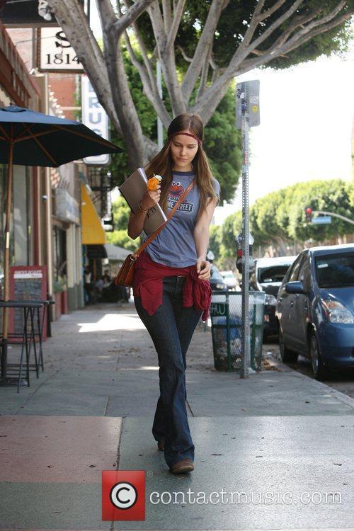 Isabelle Lucas  leaving a cafe on Hillhurst...