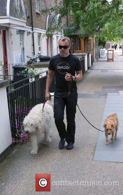 Walking his dogs near the ITV studios
