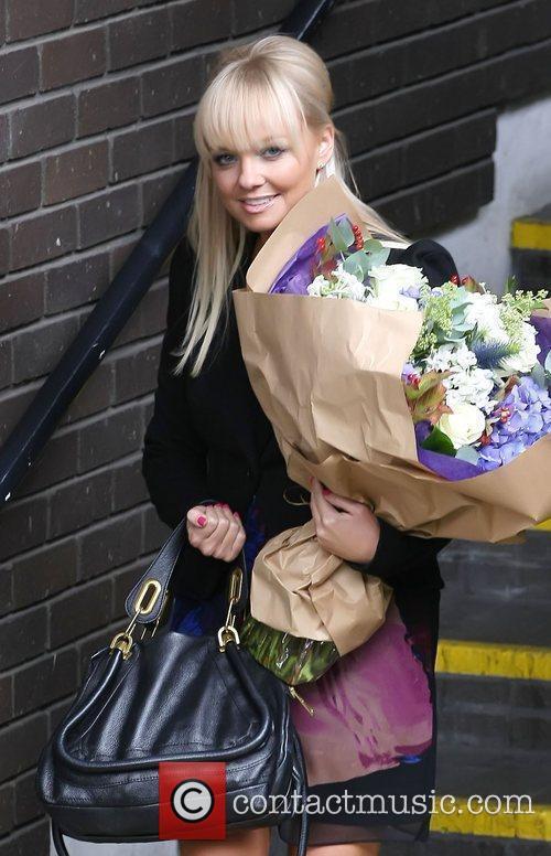 Emma Bunton carrying flowers outside the ITV studios...