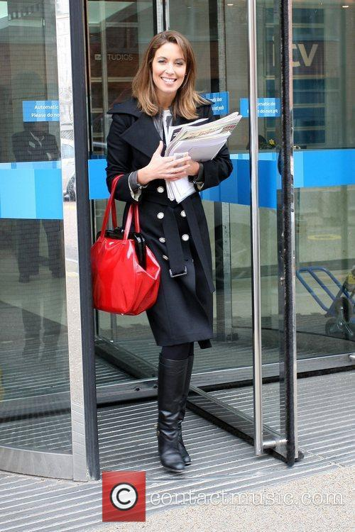 Emma Crosby outside the ITV studios carrying a...