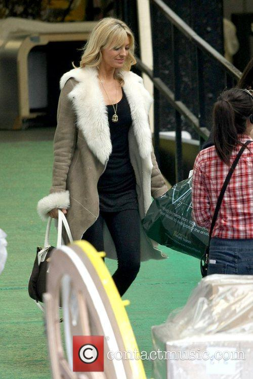 Tess Daly outside the ITV studios carrying a...