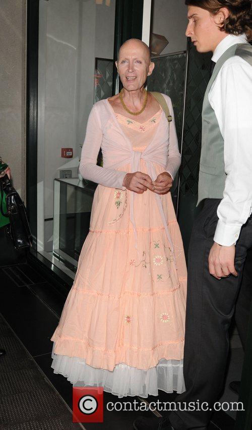 Richard O'Brien in a long peach floral dress...