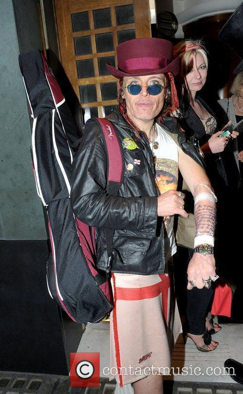 Adam Ant at the Ivy with new tattoos...