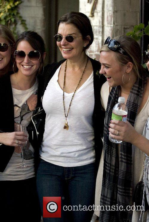 Sela Ward poses for pictures with fans as...