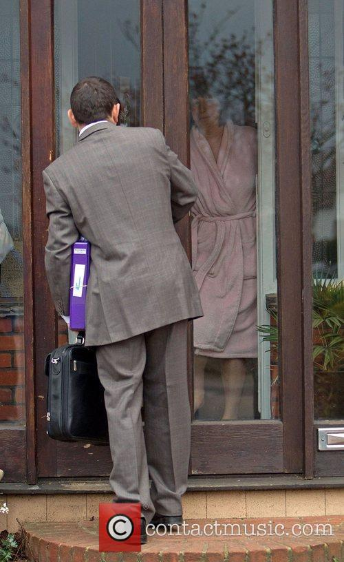 Jack Tweed's mother answers her front door before...