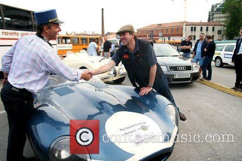 Arrive in Venice in their 1950's D-Type Jaguar...