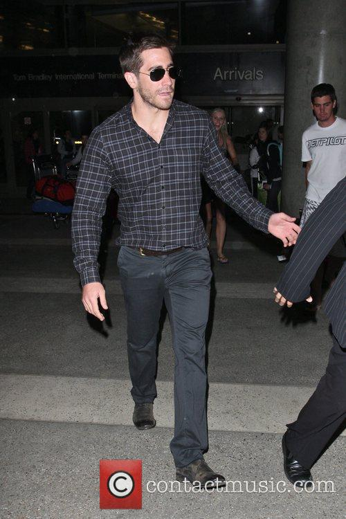Arrives at LAX airport on a flight from...