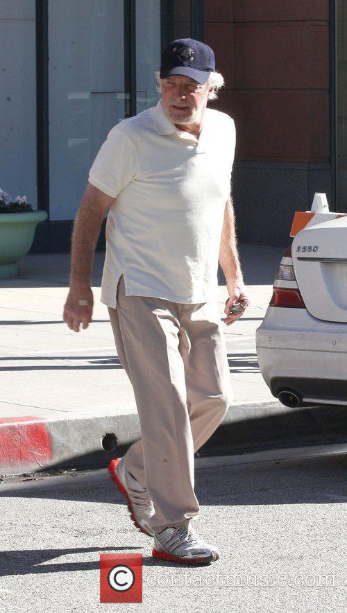 James Caan waeing a baseball cap and trainers...