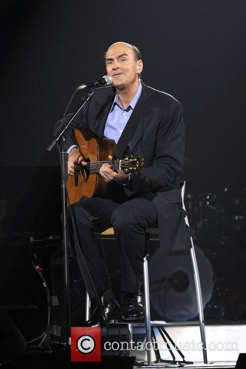 James Taylor performing on stage during the 'Troubadour...