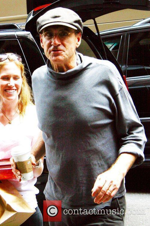 James Taylor arriving at his Manhattan hotel with...