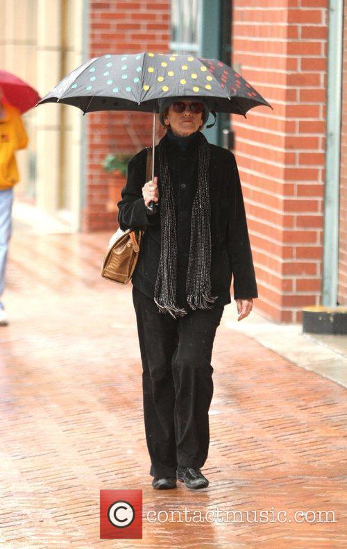 Jane Fonda gets caught in the rain while...