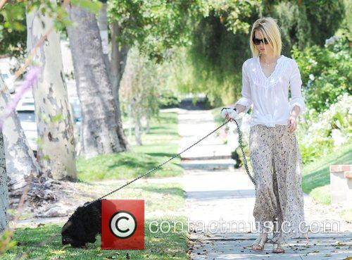 Is seen walking her dog and then heads...
