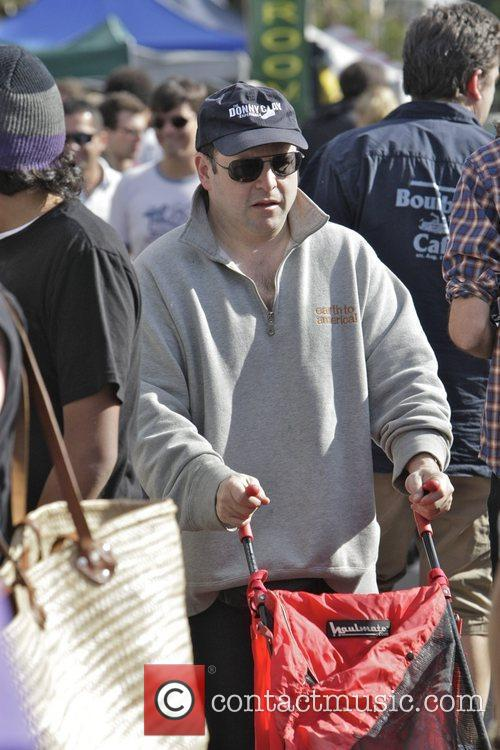 Jason Alexander pushing a stroller while out shopping...
