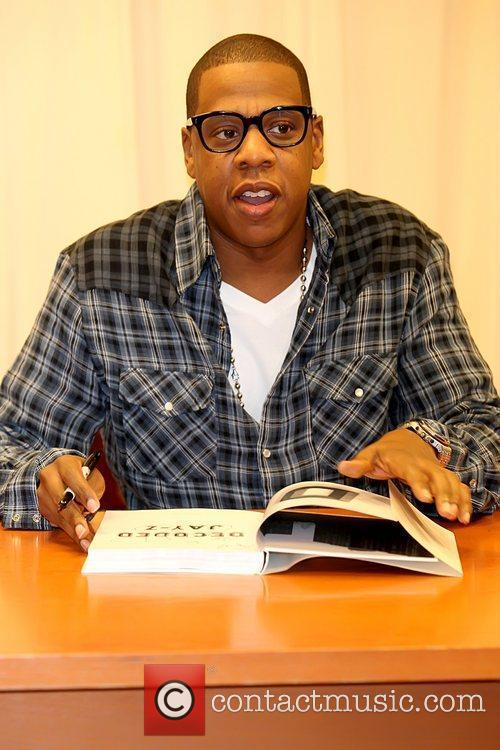 Jay-Z aka Shawn Carter signs copies of his...