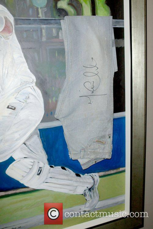 Denim jeans autographed by Michael Clarke for Jeans...