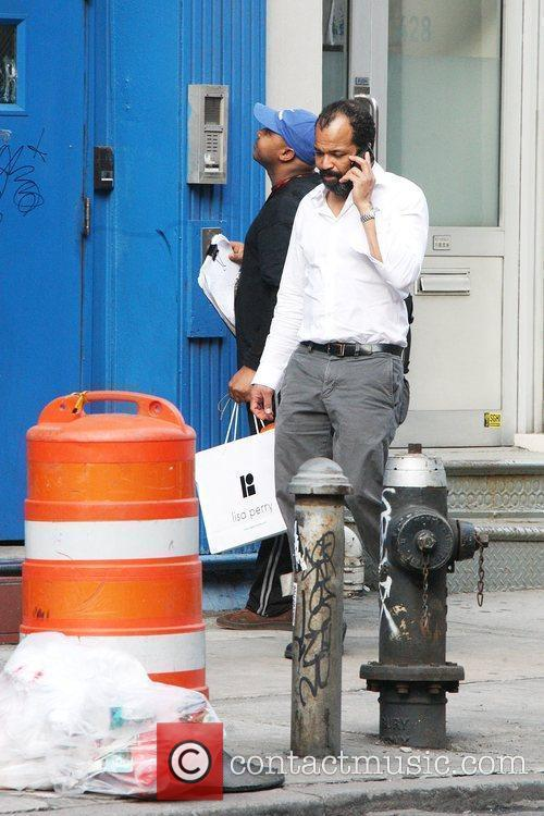 Jeffrey Wright talking on his phone while out...