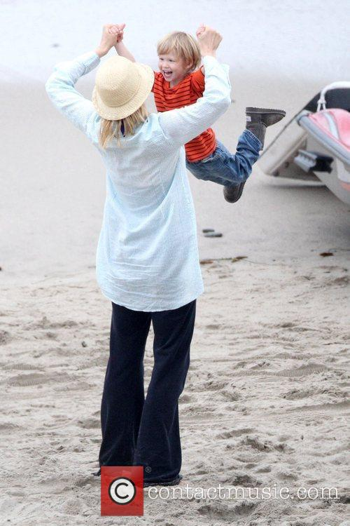 Jenna Elfman plays with her son while taking...