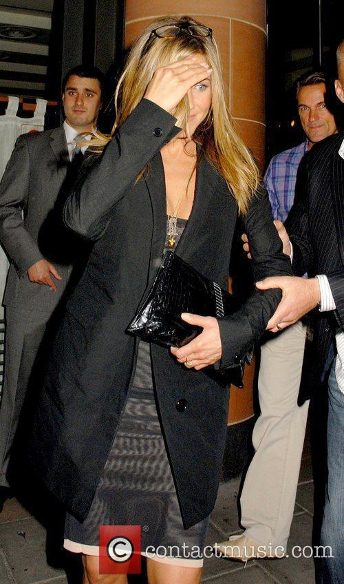 Leaving C London restaurant carrying a black clutch