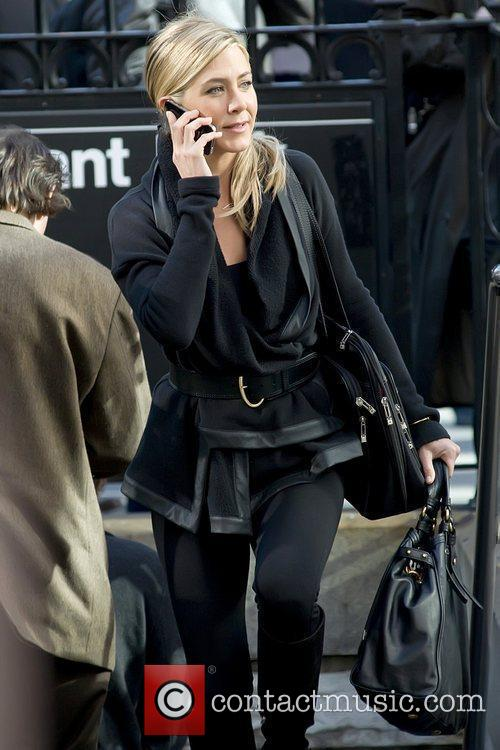 Jennifer Aniston talking on a cell phone on...