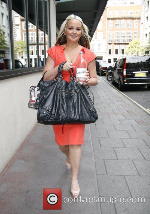 Jennifer Ellison in an orange dress outside a...