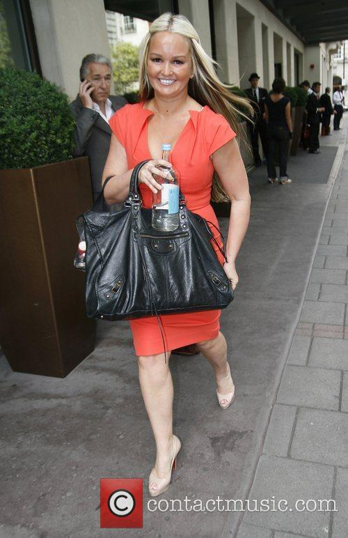 In an orange dress outside a Central London...