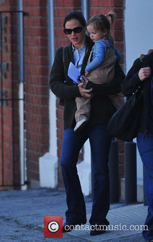 Is seen leaving a dental office with her...