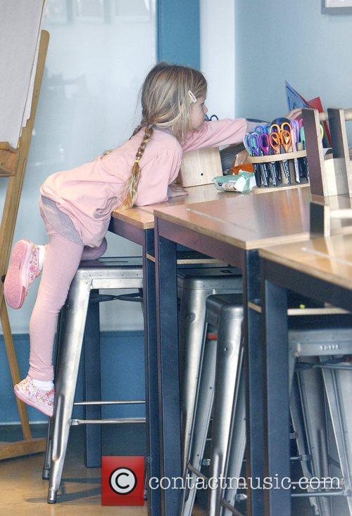 Jennifer Garner's daughter Violet Affleck climbing onto a...
