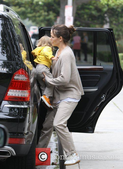 Jennifer Garner wearing a baggy jumper, out and...