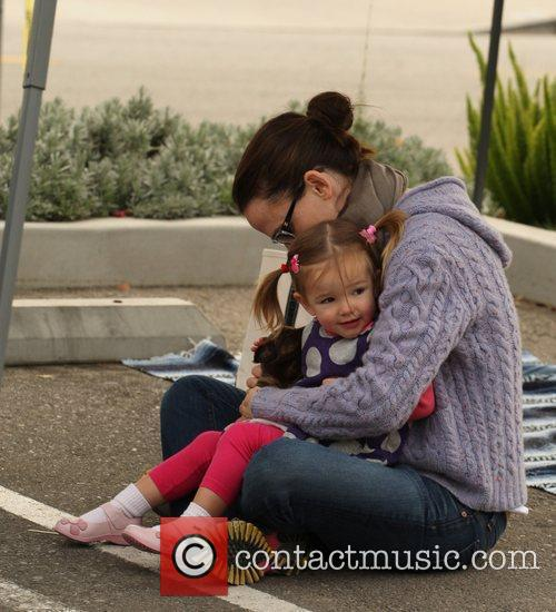 Is seen playing with her two daughters Violet...