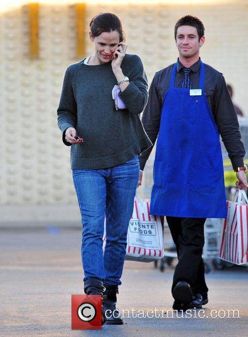 Jennifer Garner chats on her cellphone as she...