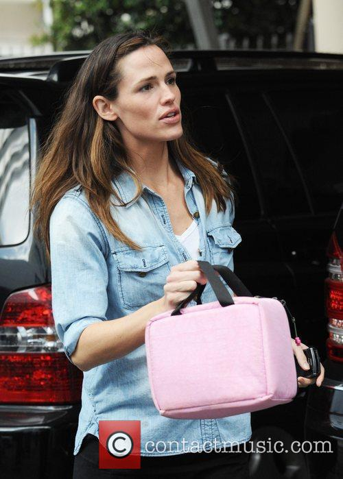 Picks up her daughter from pre-school class in...