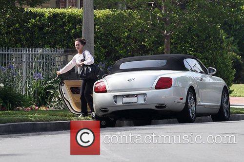 Jennifer Love Hewitt seen leaving in her white...