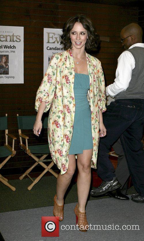 Jennifer Love Hewitt signing copies of her book...