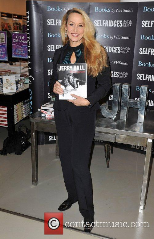 Signs copies of her book 'My Life In...