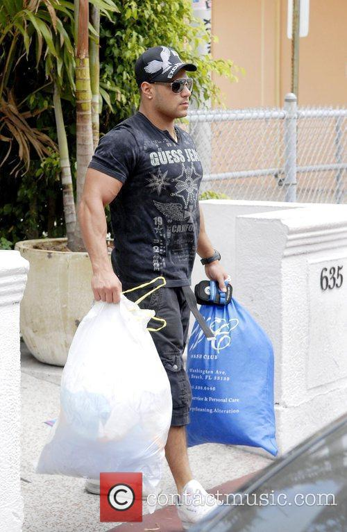 Ronnie Ortiz-Magro carrying his dirty clothes on his...