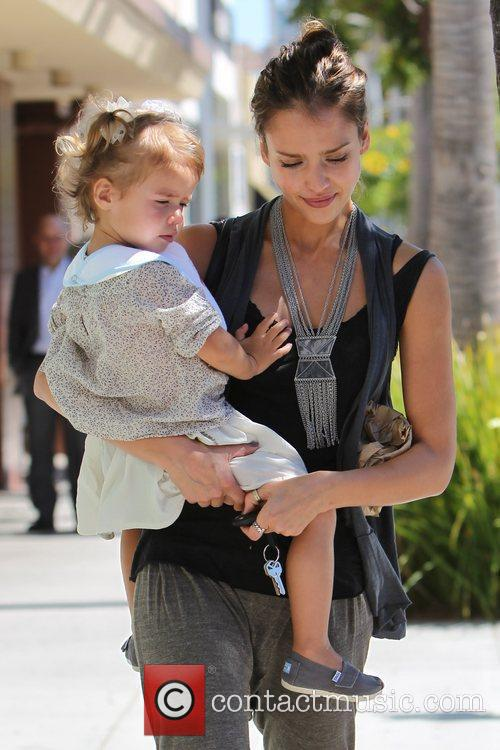 Jessica Alba, who appeared to be crying, leaves...