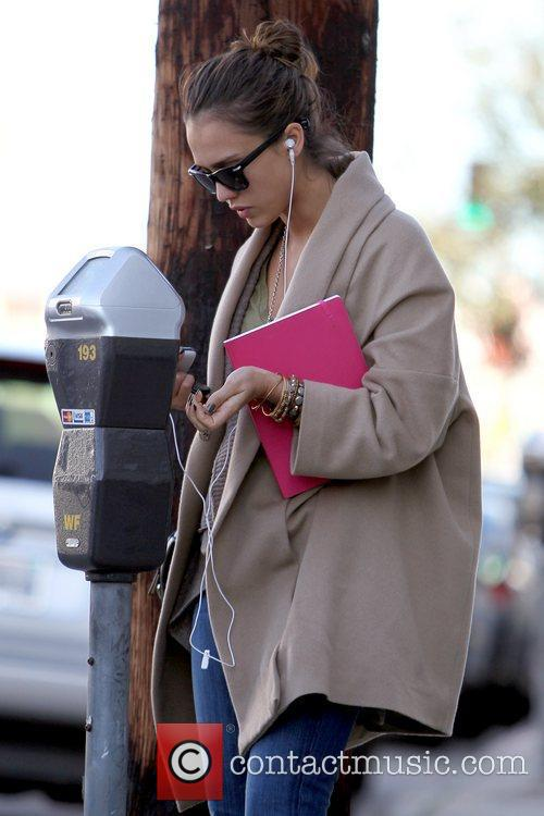 Jessica Alba paying a parking meter outside Joan's...