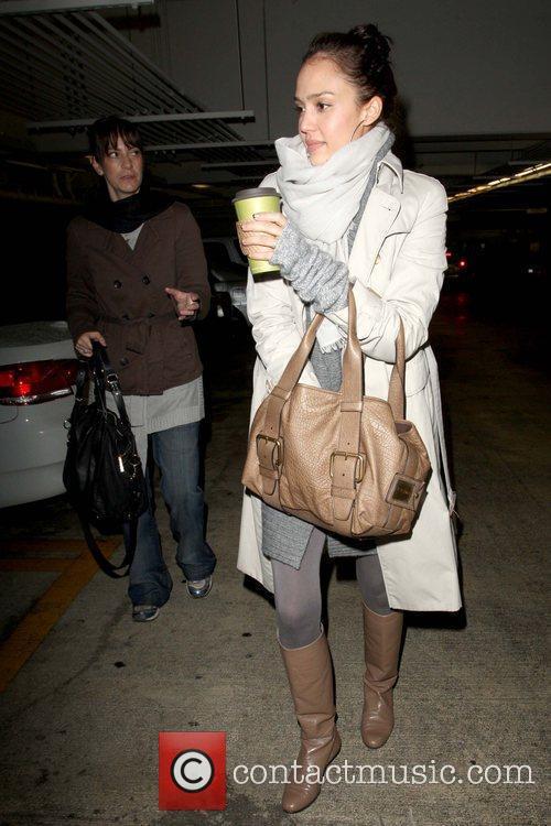 Looking through her Escada handbag while leaving Whole...