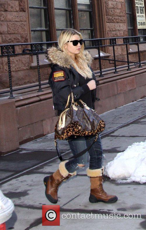 Jessica Simpson departs her hotel and heads to...