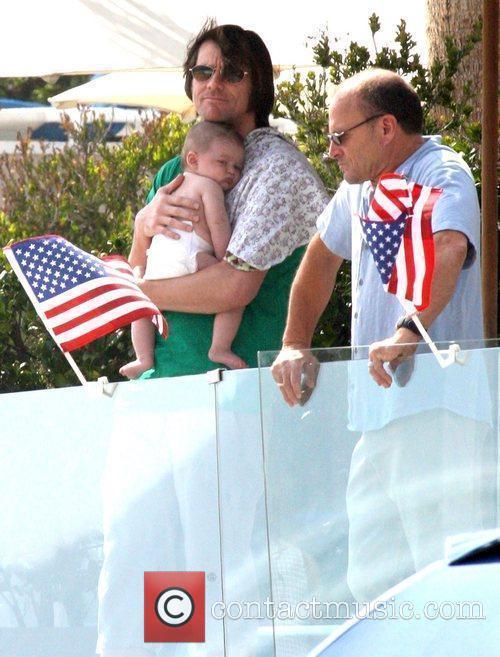 Jim Carrey holding his grandson Jackson Santana on...