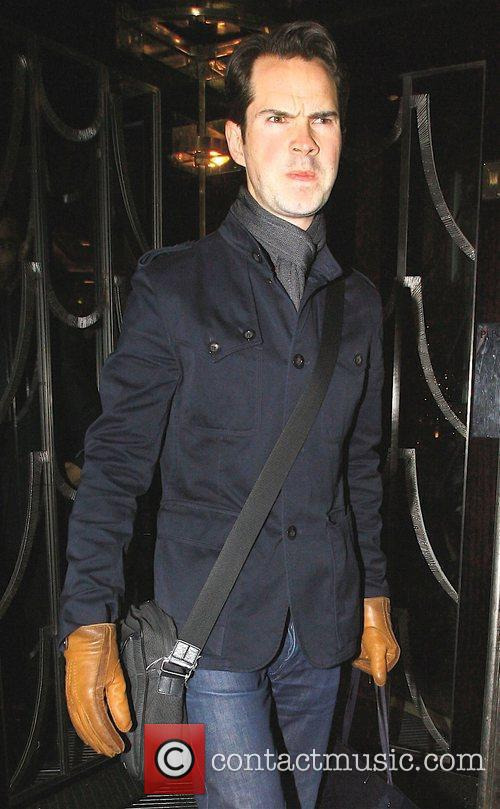 Frowning as he leaves Claridges Hotel
