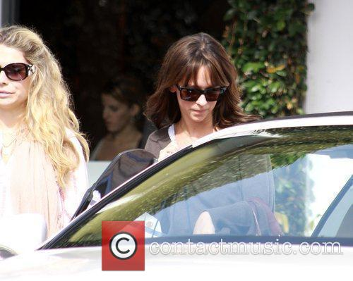 And her personal assistant leaving the Fred Segal...
